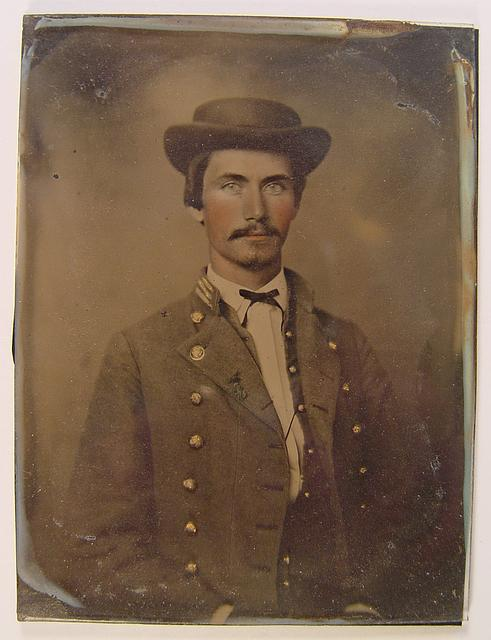 [Soldier in Confederate captain's uniform]