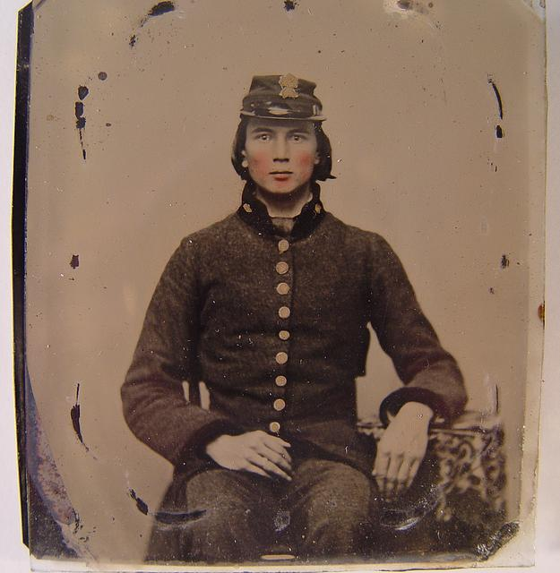 [Unidentified young soldier in Confederate uniform and South Carolina forage cap with Palmetto insignia]