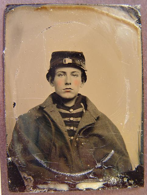 [Unidentified young soldier in Union musician's uniform and coat]