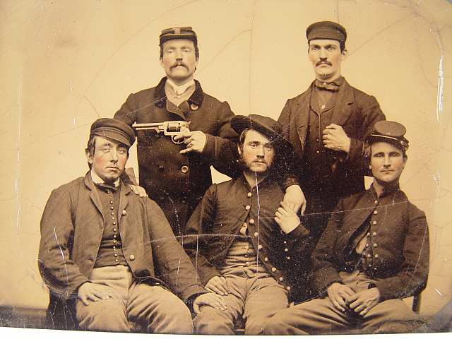 [Three unidentified men in Union uniforms and two unidentified men, one pointing a revolver at another's head]
