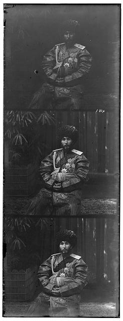[Isfandiyr, Khan of the Russian protectorate of Khorezm(Khiva), three-quarter length portrait, in official robes, seated on chair, outdoors]