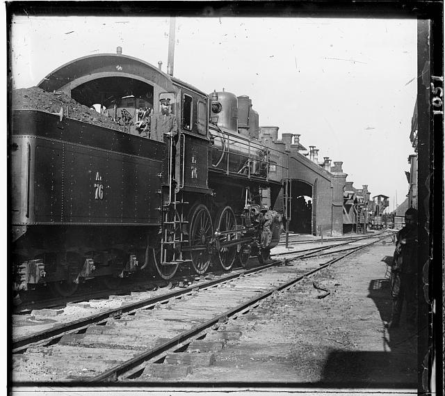 [Locomotive and coal car at a railroad yard]