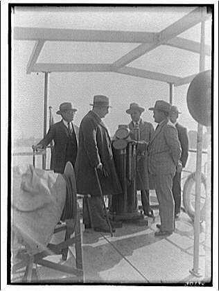 Miscellaneous subjects. Cuban ambassador inspecting cement boat of Lone Star Cement Co. I