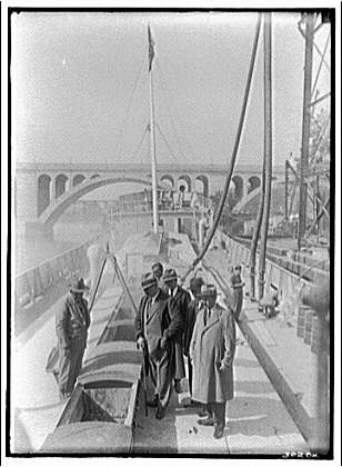 Miscellaneous subjects. Cuban ambassador inspecting cement boat of Lone Star Cement Co. II