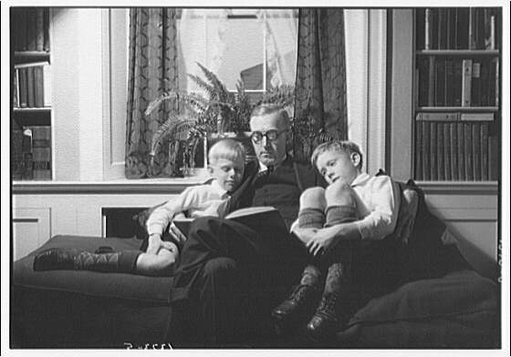 Wyckoff children. Two boys and father reading on couch I