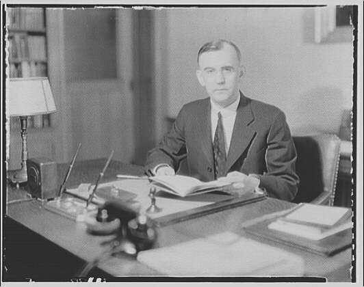 Dr. Joseph Quincy Adams, first director of the Folger Library. Dr. Adams at desk IV