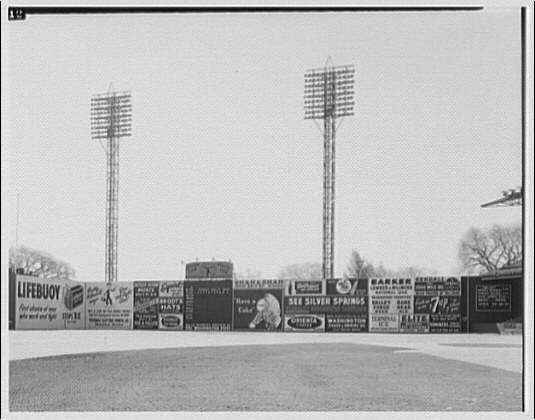 Baseball game at Griffith Stadium. All signs between first base and centerfield