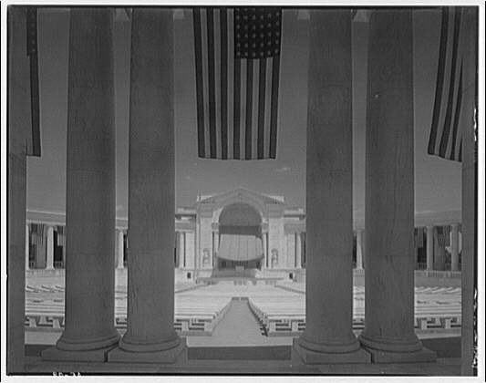 Arlington National Cemetery. Horizontal interior of Arlington National Cemetery Amphitheater through columns with flags