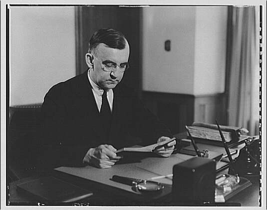 Dr. Joseph Quincy Adams, first director of the Folger Library. Dr. Adams at desk III