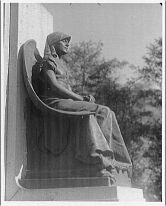 Folger Library. Sculpture of seated woman at Folger Library