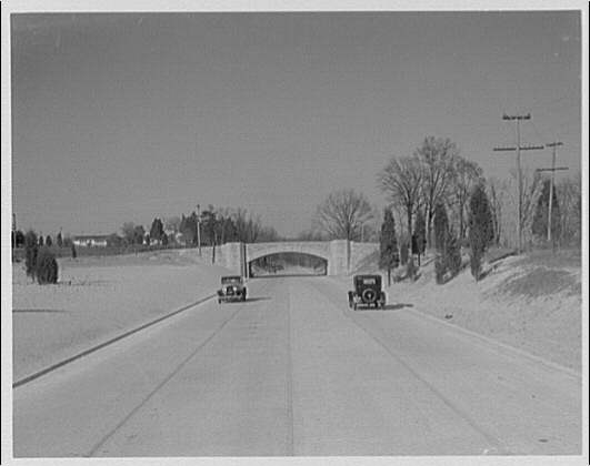 Mount Vernon Memorial Highway. Two automobiles on Mount Vernon Highway