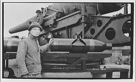 Theodor Horydczak and family. Theodor Horydczak standing next to 12-inch projectile