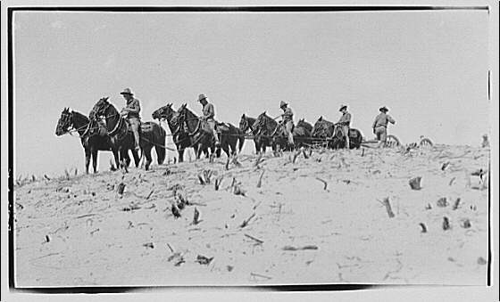 Military subjects. Soldiers on horses pulling a canon