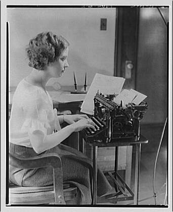 R.D. Wyly Advertising. Secretary typing documents