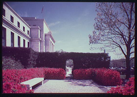 Federal Reserve Building, Constitution Ave. Federal Reserve with azaleas and marble bench in foreground, wide angle