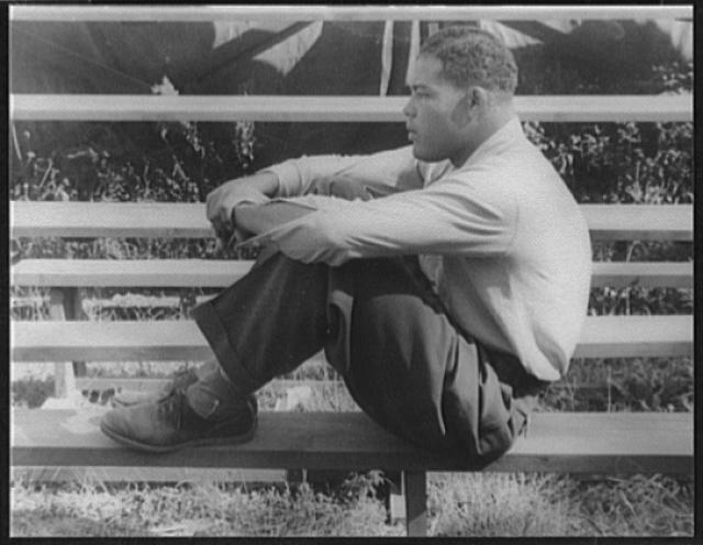 [Portrait of Joe Louis (Joe Louis Barrow), seated on bleacher(?) Greenwood Lake, New Jersey]