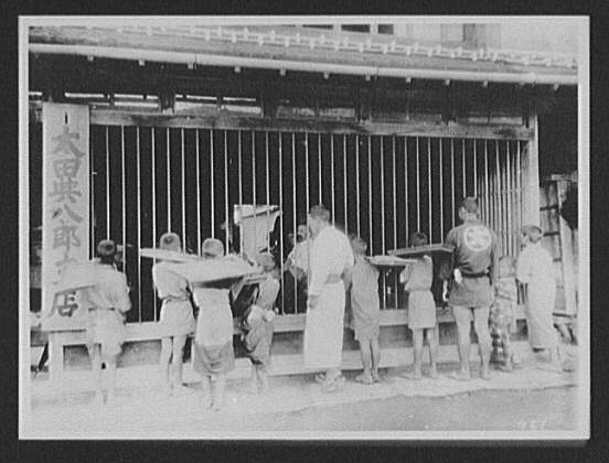 Miyajima - Japanese men and boys looking into Inn where WTC [i.e. World Transportation Commission] members are watching show
