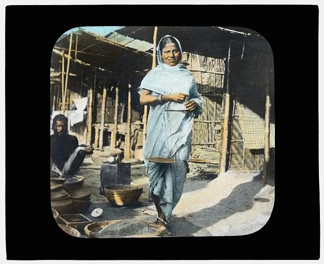 Young woman street vendor holding measuring scales