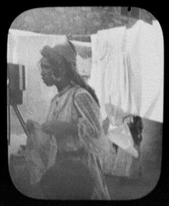 Woman with laundry hanging on clothesline