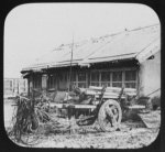 Cart in front of building in Manchu village across Amur River from Blagovestchenck [i.e. Blagoveshchensk]