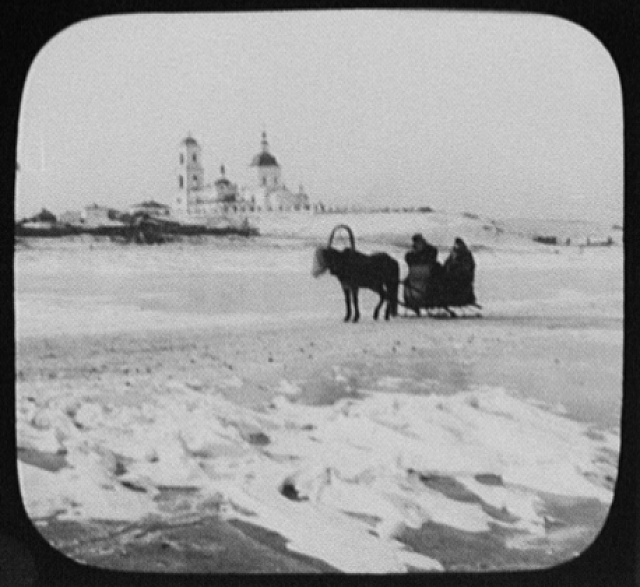 Krasnoyarsk - distant view of church with pony-drawn sledge in foreground